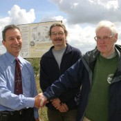 Gilbert Green from Wiltshire Geology Group with quarry managers unveiling an information board at a Wiltshire quarry.