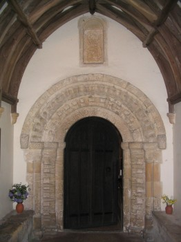 "This Norman arch has been carved from a fine oolitic limestone or ""freestone""."