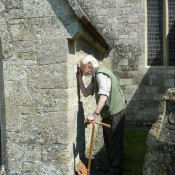 Assessing building stones at Chilmark Church, Wiltshire. Chilmark Stone is famous for its use in Salisbury Cathedral.